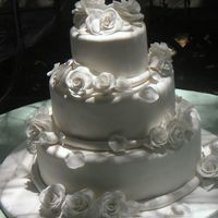 3 Tier White Rose Wedding Fondant covered with fondant roses in all white.