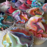 Rainbow Cupcakes Vanilla cupcakes topped with homemade color swirled buttercream!