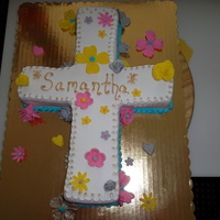 Cross First Communion This is a butter yellow cake, topped with fondant and flowers made from gumpaste as accents, the borders and name are piped with royal...