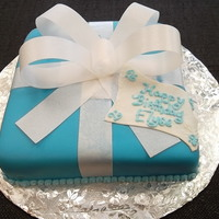 Box And Bow Cake This is an 8 inch square cake topped with tiffany blue fondant and a rice paper bow!