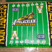 Appalachian State This is a full sheet cake topped with buttercream, a printed sugar sheet and a few fondant accents!