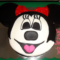 Minnie Mouse An 8 inch round is topped with 2 6 inch rounds and covered with buttercream and fondant accents, the bow is red gumpaste.....