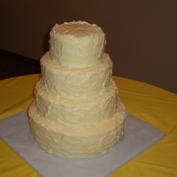 4 Tiers Textured This was a last minute order, but we were glad to make it! Its a buttercream topped cake in butter yellow color with a textured/whipped...