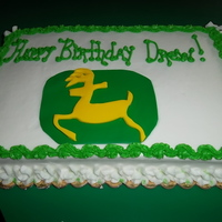 John Deere This is a 1/4 sheet cake with a logo cut out of fondant with buttercream accents~
