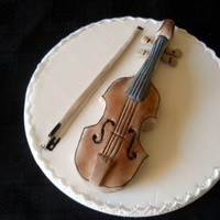 Violin Cake Topper   This is free hand molded from icing. I couldn't find a mold for a violin so I copied a picture from a book.