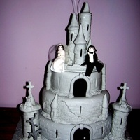 Count Dracula And His Brides Castle  Made up of fruit cakes this is a wedding cake made for a gothic couples wedding. It has bats on wires, the count & his bride, a dead...