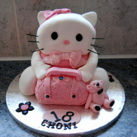 18Th Kitty Cake   Kitty cake with handbag and teddy bear. The Kitty and handbag are all cake the bear is icing.