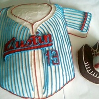 Old Time Baseball Hand carved baseball jersey, glove, and ball. Made to look like old time baseball jerseys. This is all cake and buttercream frosting.