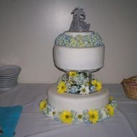 "The ""everything Went Wrong Cake"" Yellow cake, with buttercream filling. Fondant with real flowers"