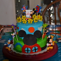 Mickey Clubhouse   Buttercream frosting and modeling chocolate decorations except the figurines are my grandsons.