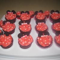 Minnie Mouse  Chocolate Mocha cupcakes with buttercream frosting fondont bowties mini oreos for ears. I just had to add the dots to make it more Minnie...