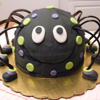 Cutesy Spider Black spider cake with lime green and purple spots. Licorice wheel legs and fondant footsies! The cake was yellow and marble. My FIRST...
