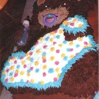 Teddy Bear Baby Shower Cake   Teddy Bear holding a blanket & bottle and sucking a pacifier.