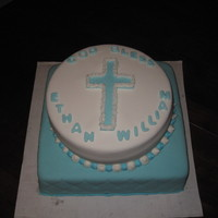 Christening Cake 12 inch square cake filled and covered with fondant and a 10 inch round filled cake.