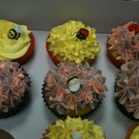 Flower Cupcakes Cupcakes decorated with flowery / grass buttercream with homemade ladybirds and bees