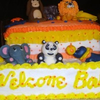 Baby Animals Bed Cake Made for a Baby Shower, two 13x9 layers, one vanilla, one strawberry and the bed was triple chocolate. The bed frame was made from...
