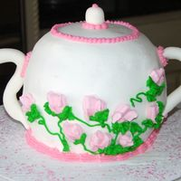 Teapot.jpg   All buttercream with royal icing rose buds. Fondant handle and spout.