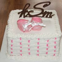 Pink Booties White cake with fondant booties. Chocolate monogram intials.