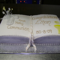 First Communion Cake My nephew wanted his cake shaped into a book , so i used 2 rectangle tins, I placed them side by side and carved out where they joined to...