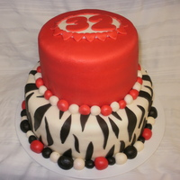 My First Fondant Cake  This was my first MMF cake which happened to be my birthday cake which was yesterday. The bottom tier is lemon cake with lemon filling, the...