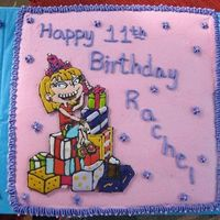 "Angelina From Rugrats All Grown Up Made this cake for my niece's 11th Birthday. I used color flow to make Angelica from ""Rugrats - All Grown Up"". Took me a few..."