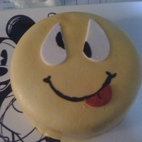 Smilie a cute smilie cake made one night when I got really bored and wanted to try out my new airbrush... =)
