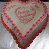 Heart Anniversary Wiltonâs Sweetheat pan. Cake is CMD Basic Buttermilk Devilâs food with Bavarian filling. Icing is CMD White Chocolate...