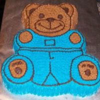 Class Teddy Bear Cake Pan My first cake from second week of class. This is my first time with acharacter cake pan. Cake is WASC and icing is class icing. Had to...