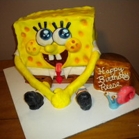 Sponge Bob Cake I made this cake with a sheet cake stack up on dowel rod and covered and decorated with fondant. The little girl loved it = )