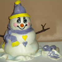 Snowman Cake  snowman cake is two ball cakes stack with dowel rod in the center and fondant draped and shaped over them to form the classic snowman shape...