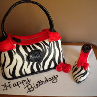 Purse And Shoe Cake This cake is cover in fondant and hand painted. This was the first time I have ever did a shoe. I think it turned out nicely. My customer...