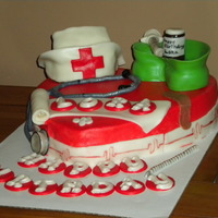 Nurses Cake   This cake is buttercream cake with fondant accents. She loved it