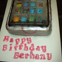 I Phone Cake hand painted apps on frosting sheet and then airbrushed a textured fondant silver