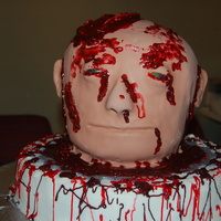 "Severed Head Head and base are all cake the ""blood"" is colored piping gel, this is the grosest thing I have ever done or will ever do again."