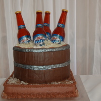 "Miller Light Grooms Cake the bottles and ""ice"" are made from hard candy using isomalt"