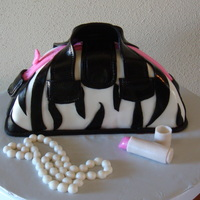 Zebra Print Handbag Chocolate fudge cake covered in mm fondant.. All the details were also made of mm fondant. This was my first experience with making a purse...