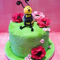 "Buzzy   This cake is small, only a 4"" round. Bee & flowers all made out of fondant with gum tragacanth added."