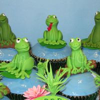 Frog Pond  White chocolate & raspberry mud cakes with white chocolate ganache & fondant icing. Frogs made out of fondant with gum tragacanth...