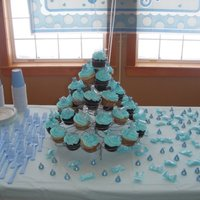 Baby Boy Shower These are chocolate and vanilla cupcakes iced in baby blue buttercream with baby blue sugar crystals on top. Ice cream cakes are made out...