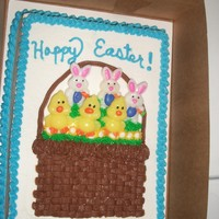 Easter Cake 1/4 sheet cake decorated for Easter. The bunnies and chicks are suckers that I stuck into the basket.