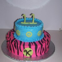 Zebra Stripes And Peace Signs white cake covered in BC and zebra stripes, peace signs and 11 was made of MMF.