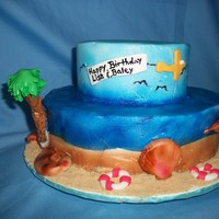 Beached Themed Birthday Cake Beach themed birthday cake, BC airbrushed with MMF sea shells, airplane, and other accents. Graham cracker sand. Only the 2nd time using...