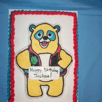 Special Agent Oso 1/4 sheet cake with Special Agent Oso. Decorated in BC.