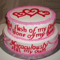 Adoption Cake 2 tier oval cake made for an adoption party. Decorated with BC and MMF letters and hearts. The cake says: Not flesh of my flesh, nor bone...