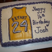 Kobe Bryant Birthday Cake A red velvet sheet cake made with colored cream cheese icing and fondant jersery.