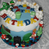 Super Mario Cake all edible apart from Mario and luigi. thanks for looking :)