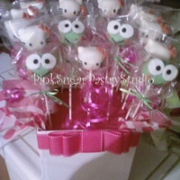 Hello Kitty And Keroppi Cake Pops One of the photos of the first cake pops I made (Hello Kitty and Keroppi).It's red velvet cake and covered in white chocolate.