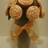 Peach Rose Cupcake Bouquet this is my second cupcake bouquet ever made - light peach colored roses on vanilla cupcakes frosted with cream cheese icing in a ceramic...