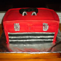 Toolbox Cake Carved Toolbox Cake, Almond Buttercream filling with Fondant covering.
