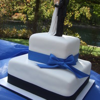 Simple Wedding My first wedding cake. Marble cake and buttercream icing/filling under MMF. Bride wanted the black and blue ribbon...not my first choice in...